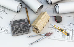 Calculator, tools designer and wooden house on projects Royalty Free Stock Photo
