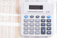 Calculator on top of newspaper Stock Photography