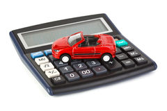 Calculator and toy car Royalty Free Stock Images