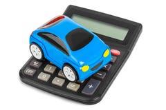 Calculator and toy car Stock Photos