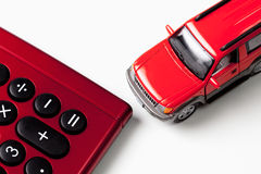 Calculator and toy car on white background Royalty Free Stock Photo