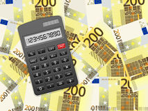 Calculator on two hundred euro background Royalty Free Stock Photos