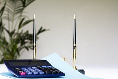 Calculator and two pens Stock Image