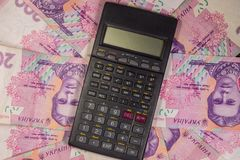 Calculator on the Ukrainian two hundred hryvnia bills background. Black calculator on the Ukrainian two hundred hryvnia bills background stock images