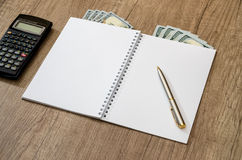 Calculator, us dollar, notebook with pen Stock Photography