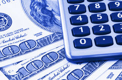 Calculator on US dollars. Background,dual tone Royalty Free Stock Photos