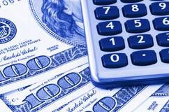 Calculator on US dollars Royalty Free Stock Photos