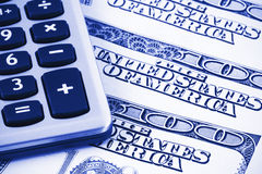 Calculator on US dollars. Background,dual tone Royalty Free Stock Photo