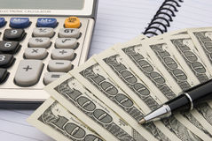 Calculator and us dollars Stock Photo