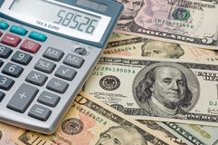 The calculator and US dollars Stock Photos