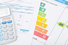 Calculator with utility bill and energy rating chart royalty free stock images