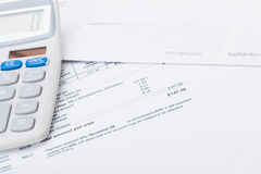 Calculator with utility bill under it Stock Images