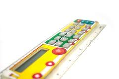 Calculator voor schoolkinderen In de vorm van een lijn met het beeld van een paravoz Stock Afbeeldingen