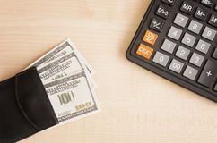 Calculator and wallet with money Royalty Free Stock Photos