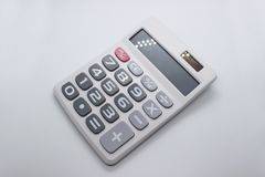 A calculator on white background. And big numbers Stock Photos