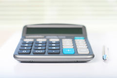 Calculator on a white table Stock Images