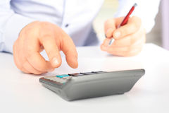 Calculator on a white table Stock Photography