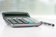 Calculator on a white table Stock Photos