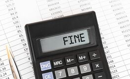 Free Calculator With The Word Fine On The Display Royalty Free Stock Photography - 195436187
