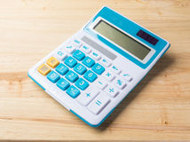 Calculator on wood background Stock Photo