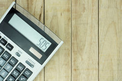 Calculator on wood pattern background Royalty Free Stock Photo