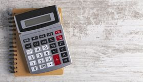 Calculator wooden background royalty free stock images