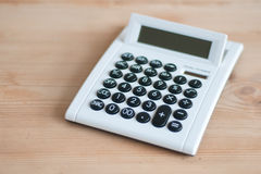 Calculator on wooden desk Royalty Free Stock Image