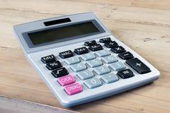 Calculator on wooden desk. stock photos