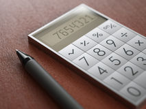 Calculator on wooden table Royalty Free Stock Photos