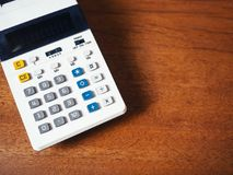 Calculator on wooden table Financial Business concept Royalty Free Stock Image