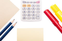 Calculator, writing objects and paper on white background Royalty Free Stock Photo