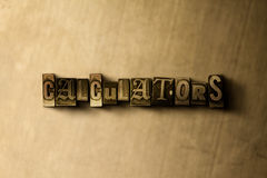 CALCULATORS - close-up of grungy vintage typeset word on metal backdrop Royalty Free Stock Images