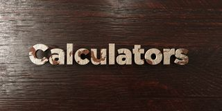 Calculators - grungy wooden headline on Maple  - 3D rendered royalty free stock image Royalty Free Stock Photos