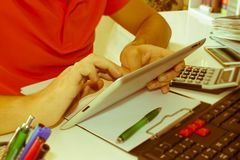 The calculators,  ipad, business owners, accounting and technology, business, computer, calculator and documents in the office Stock Photography