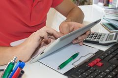 The calculators,  ipad, business owners, accounting and technology, business, computer, calculator and documents in the office Royalty Free Stock Images