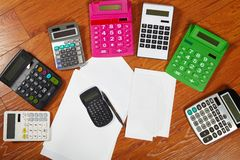 Calculators lying on the wooden flooring Royalty Free Stock Photo