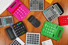 Calculators lying on the wooden flooring Royalty Free Stock Image