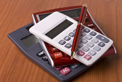 Calculators and pen Royalty Free Stock Photos