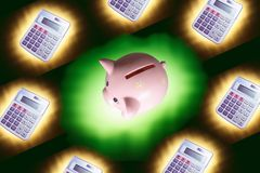 Calculators and Piggy Bank Royalty Free Stock Image