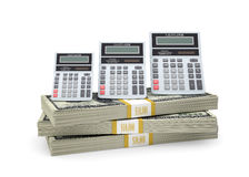 Calculators stand on pack of dollars Stock Photos