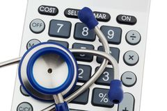 Calculators and stethoscope Stock Photography