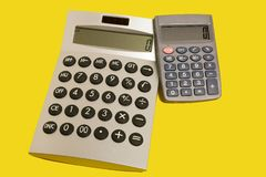 Calculators on a yellow surface