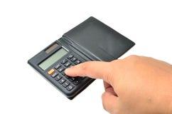 Calculatrice avec le doigt photographie stock libre de droits