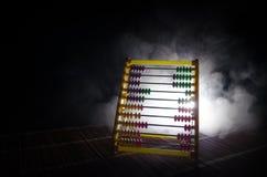 Calculatrice chinoise avec les perles colorées sur le fond orange d'obscurité de fumée du feu Photo de concept des affaires, enfa Image libre de droits