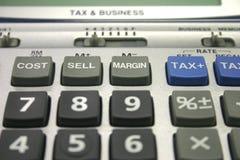 Calculatrice d'impôts et d'affaires Photographie stock
