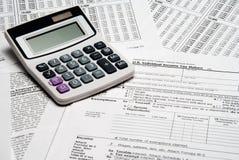 Calculatrice d'impôts Photographie stock libre de droits