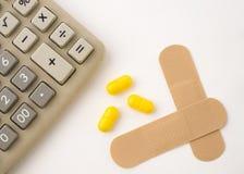 Calculatrice dans la santé faible Photos libres de droits