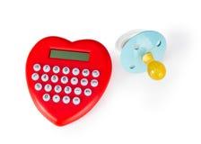 Calculatrice en forme de coeur et tétine Photos stock