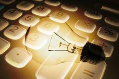Calculatrice et ampoule Images libres de droits