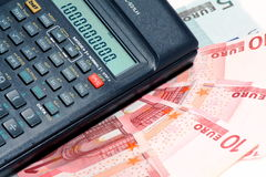 Calculatrice et argent Photographie stock